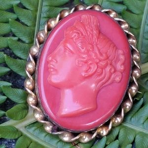 Vintage carved coral art deco brooch